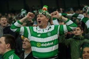 Er waren ook vrolijke fans uit Schotland. © EPA