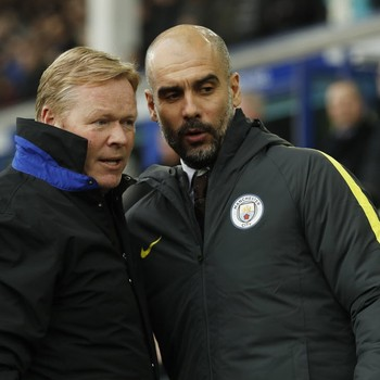 Ronald Koeman en Pep Guardiola. © Reuters.